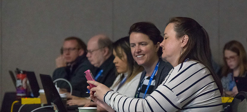 Attendee sharing phone screen with another attendee